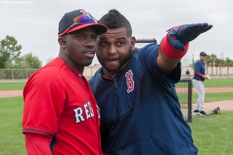 """Boston Red Sox outfielder Rusney Castillo and third baseman Pablo Sandoval talk during a team workout at JetBlue Park in Fort Myers, Florida Friday, February 27, 2015."""
