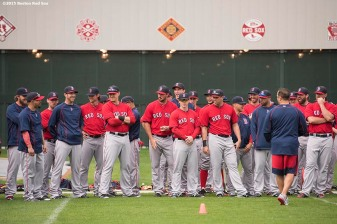 """Members of the Boston Red Sox line up as Strength Coach Pat Sandora talks during a team workout at JetBlue Park in Fort Myers, Florida Friday, February 27, 2015."""