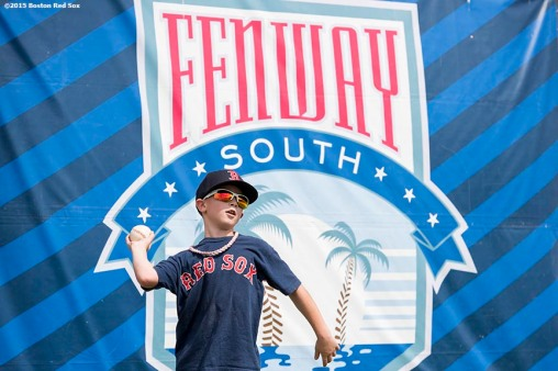 """A young fan plays catch during a team workout at JetBlue Park in Fort Myers, Florida Saturday, February 28, 2015."""