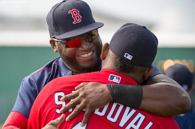 """Boston Red Sox designated hitter David Ortiz hugs third baseman Pablo Sandoval during a team workout at JetBlue Park in Fort Myers, Florida Monday, March 2, 2015."""