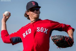 """Boston Red Sox pitcher Clay Buchholz throws during a team workout at JetBlue Park in Fort Myers, Florida Monday, March 2, 2015."""