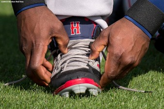 """Boston Red Sox left fielder Hanley Ramirez ties his shoe during a team workout at JetBlue Park in Fort Myers, Florida Monday, March 2, 2015."""