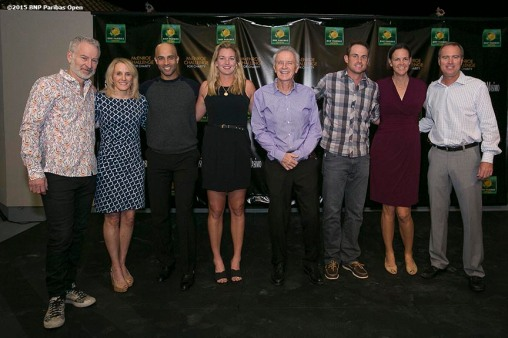 """Draw ceremony participants pose for a photograph during the McEnroe Challenge for Charity VIP Draw Ceremony in Stadium 2 at the Indian Wells Tennis Garden in Indian Wells, California Friday, March 6, 2015. From left to right: John McEnroe, Tracy Austin, James Blake, CocoVandeweghe, Raymond Moore, Andy Roddick, Lindsay Davenport, Rick Leach."""