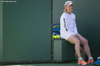 """Martina Navratilova, coach of Agnieszka Radwanska, laughs during during a practice session on Stadium 1 at the Indian Wells Tennis Garden in Indian Wells, California Friday, March 6, 2015."""