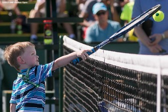 """A boy hits a volley during Kids Day at the Indian Wells Tennis Garden in Indian Wells, California Saturday, March 7, 2015."""