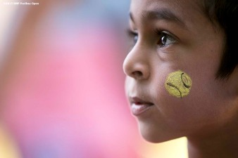 """""""A boy has his face painted during Kids Day at the Indian Wells Tennis Garden in Indian Wells, California Saturday, March 7, 2015."""""""