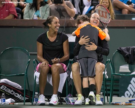 """Jagger leach hugs his mother, Lindsay Davenport, alongside Madison Keys after playing a point during the McEnroe Challenge for Charity presented by Masimo in Stadium 2 at the Indian Wells Tennis Garden in Indian Wells, California Saturday, March 7, 2015."""