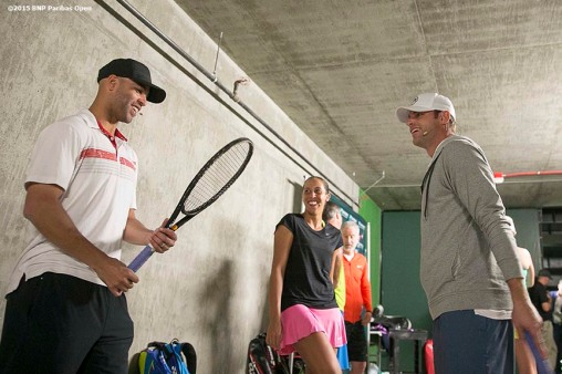 """James Blake, Madison Keys, and Andy Roddick talk below the stadium before the McEnroe Challenge for Charity presented by Masimo in Stadium 2 at the Indian Wells Tennis Garden in Indian Wells, California Saturday, March 7, 2015."""