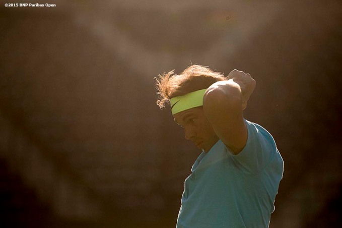 """Rafael Nadal puts on his headband during a practice session at the Indian Wells Tennis Garden in Indian Wells, California Monday, March 9, 2015."""