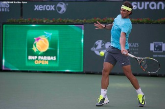 """Rafael Nadal hits a forehand during a practice session at the Indian Wells Tennis Garden in Indian Wells, California Monday, March 9, 2015."""