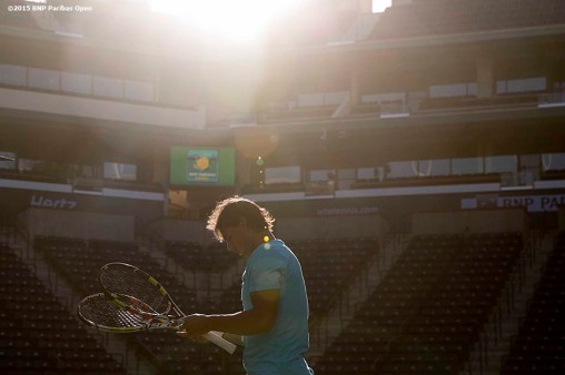 """Rafael Nadal unpacks his racquets during a practice session at the Indian Wells Tennis Garden in Indian Wells, California Monday, March 9, 2015."""