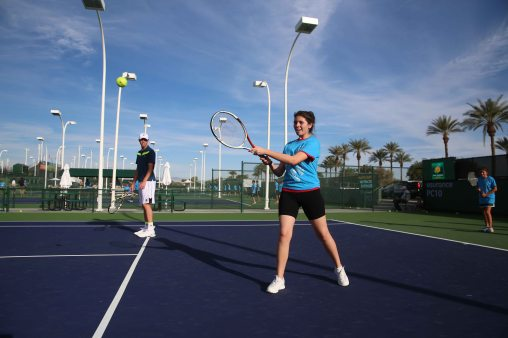 """Sam Query hosts a Fila junior tennis clinic at the Indian Wells Tennis Garden in Indian Wells, California Tuesday, March 10, 2015."""