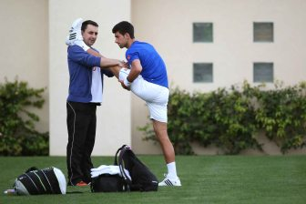 """Novak Djokovic warms up during a practice session at the Indian Wells Tennis Garden in Indian Wells, California Wednesday, March 11, 2015."""