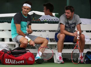 """Roger Federer and Stan Wawrinka practice at the Indian Wells Tennis Garden in Indian Wells, California Tuesday, March 11, 2015."""