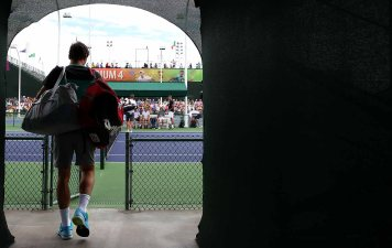 """""""Roger Federer walks to the court before practicing at the Indian Wells Tennis Garden in Indian Wells, California Tuesday, March 11, 2015."""""""