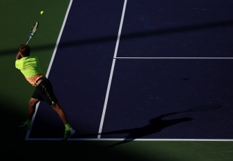 """""""Ryan Harrison in action against Mardy Fish during their match inside Stadium 1 at the Indian Wells Tennis Garden in Indian Wells, California Tuesday, March 12, 2015."""""""