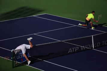 """Mardy Fish flips over the net during his match against Ryan Harrison inside Stadium 1 at the Indian Wells Tennis Garden in Indian Wells, California Tuesday, March 12, 2015."""