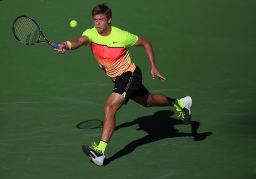 """Ryan Harrison in action against Mardy Fish during their match inside Stadium 1 at the Indian Wells Tennis Garden in Indian Wells, California Tuesday, March 12, 2015."""