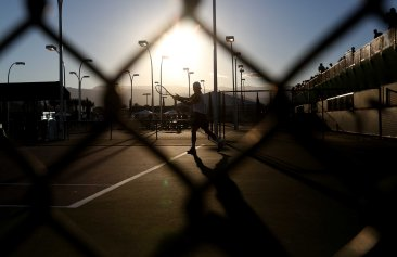 """A tennis player practices at the Indian Wells Tennis Garden in Indian Wells, California Thursday, March 12, 2015."""