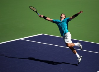 """Tim Smyczek defeats Benjamin Becker during a first round match at the Indian Wells Tennis Garden in Indian Wells, California Tuesday, March 12, 2015."""
