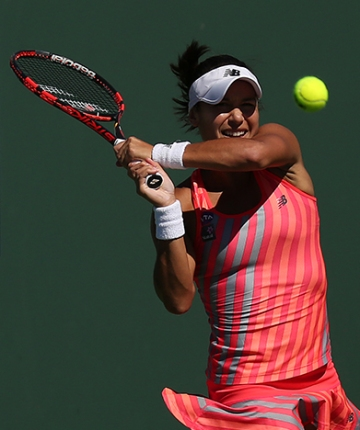 """Heather Watson in action against Camila Giorgi during their second round match at the Indian Wells Tennis Garden in Indian Wells, California on Friday, March 13, 2015."""