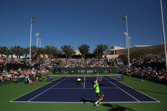 """Aisam-Ul-Haq Qureshi and Milos Raonic in action against Raven Klaasen and Leander Paes during their doubles match on Stadium 9 at the Indian Wells Tennis Garden in Indian Wells, California on Friday, March 13, 2015."""