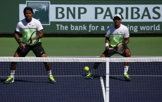 """Raven Klaasen and Leander Paes in action against Aisam-Ul-Haq Qureshi and Milos Raonic during their doubles match on Stadium 9 at the Indian Wells Tennis Garden in Indian Wells, California on Friday, March 13, 2015."""
