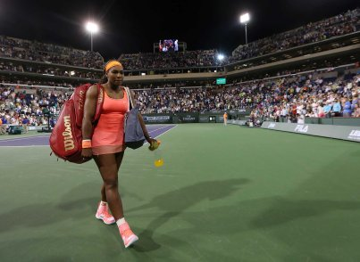 """Serena Williams walks off of the court following her win against Monica Niculescu during their match at Stadium 1 at the Indian Wells Tennis Garden in Indian Wells, California on Friday, March 13, 2015."""