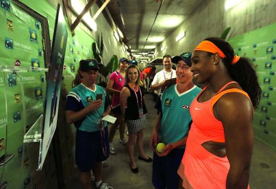 """Serena Williams poses with a ball kid for the Twitter mirror following her win against Monica Niculescu at Stadium 1 at the Indian Wells Tennis Garden in Indian Wells, California on Friday, March 13, 2015."""