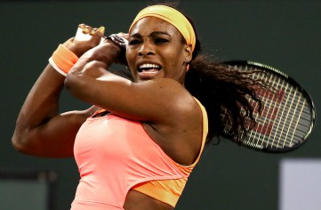 """Serena Williams plays Monica Niculescu in a second round match at the Indian Wells Tennis Garden in Indian Wells, California on Friday, March 13, 2015."""