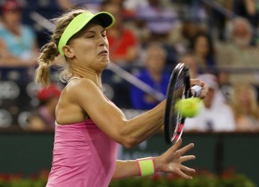 """Eugenie Bouchard in action against Lucie Hradecka during their match at stadium 1 at the Indian Wells Tennis Garden in Indian Wells, California on Saturday, March 14, 2015."""