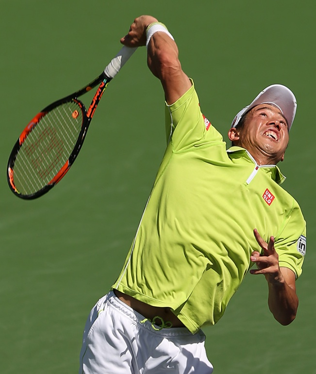 """Kei Nishikori in action against Ryan Harrison during their match at Stadium 1 at the Indian Wells Tennis Garden in Indian Wells, California on Saturday, March 14, 2015."""