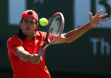 """Guillermo Garcia-Lopez in action against Thanasi Kokkinakis during their match at Stadium 4 at the Indian Wells Tennis Garden in Indian Wells, California on Saturday, March 14, 2015."""
