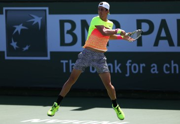 """Thanasi Kokkinakis in action against Guillermo Garcia-Lopez at Stadium 4 at the Indian Wells Tennis Garden in Indian Wells, California on Saturday, March 14, 2015."""