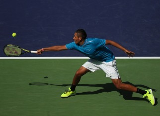 """Nick Kyrgios in action against Grigor Dimitrov during their match at stadium 1 at the Indian Wells Tennis Garden in Indian Wells, California on Sunday, March 15, 2015."""