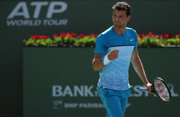 """Grigor Dimitrov in action against Nick Kyrgios during their match at stadium 1 at the Indian Wells Tennis Garden in Indian Wells, California on Sunday, March 15, 2015."""