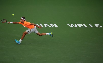 """Roger Federer in action against Diego Schwartzman during their match at stadium 1 at the Indian Wells Tennis Garden in Indian Wells, California on Sunday, March 15, 2015."""