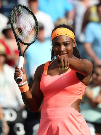 """Serena Williams waves to the crowd and hits autographed tennis balls into the stands following her win against Zarina Diyas at stadium 1 at the Indian Wells Tennis Garden in Indian Wells, California on Sunday, March 15, 2015."""