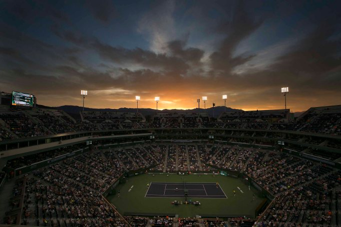 """Sun sets over Stadium 1 at the Indian Wells Tennis Garden in Indian Wells, California on Monday, March 16, 2015."""