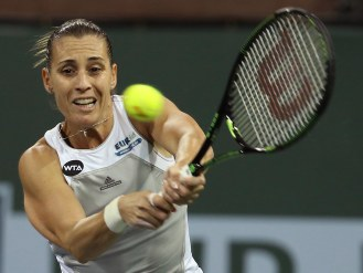 """Flavia Pennetta in action against Samantha Stosur during their match at stadium 2 at the Indian Wells Tennis Garden in Indian Wells, California on Monday, March 16, 2015."""