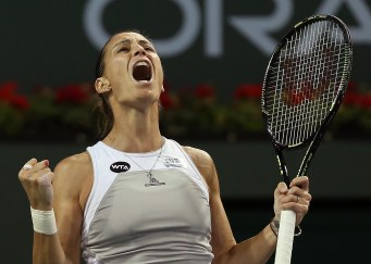 """Flavia Pennetta celebrates following her win against Samantha Stosur during their match at stadium 2 at the Indian Wells Tennis Garden in Indian Wells, California on Monday, March 16, 2015."""