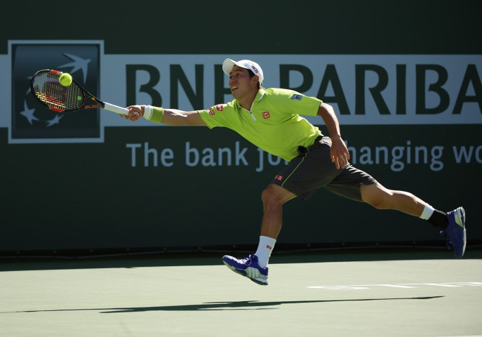 """Kei Nishikori in action against Fernando Verdasco during their match at stadium 2 at the Indian Wells Tennis Garden in Indian Wells, California on Monday, March 16, 2015."""