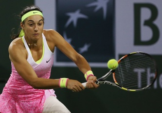 """Caroline Garcia in action against Sabine Lisicki during their match at stadium 1 at the Indian Wells Tennis Garden in Indian Wells, California on Tuesday, March 17, 2015."""