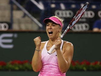"""Sabine Lisicki reacts following her win against Caroline Garcia during their match at stadium 1 at the Indian Wells Tennis Garden in Indian Wells, California on Tuesday, March 17, 2015."""