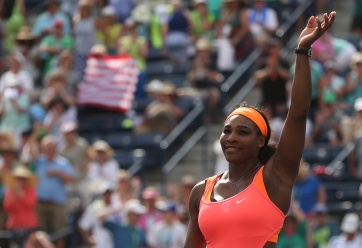 """Serena Williams celebrates her win against Sloane Stephens during their match at stadium 1 at the Indian Wells Tennis Garden in Indian Wells, California on Tuesday, March 17, 2015."""