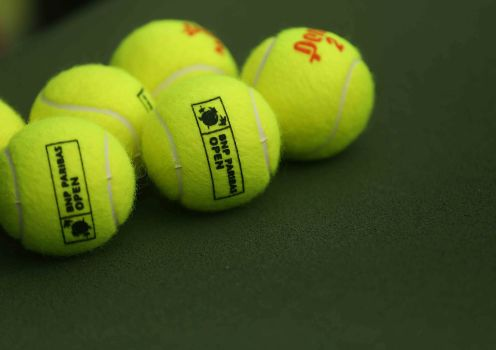 """A set of tennis balls sit on the court during the match between Rafael Nadal and Donald Young at stadium 1 at the Indian Wells Tennis Garden in Indian Wells, California on Tuesday, March 17, 2015."""