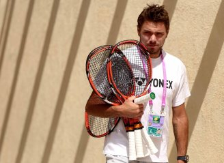 """Stan Wawrinka walks through the player area at the Indian Wells Tennis Garden in Indian Wells, California Wednesday, March 18, 2015."""