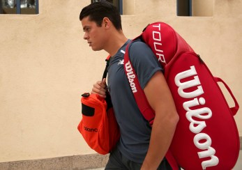 """Milos Raonic walks toward stadium one before a match against Tommy Robredo at the Indian Wells Tennis Garden in Indian Wells, California Wednesday, March 18, 2015."""