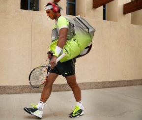 """Rafael Nadal walks toward stadium one before a match against Gilles Simon at the Indian Wells Tennis Garden in Indian Wells, California Wednesday, March 18, 2015."""