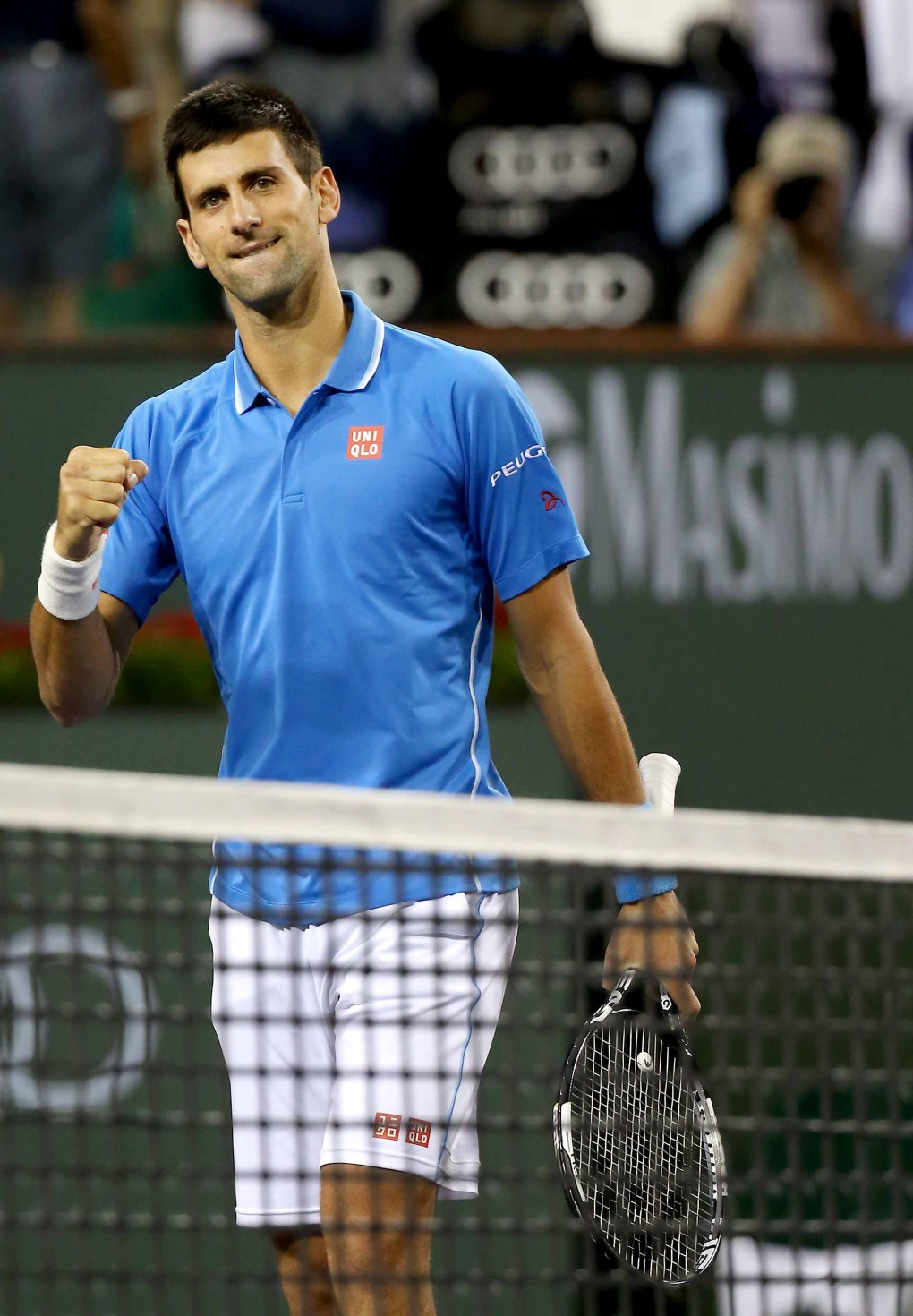 """A fourth round match between Novak Djokovic and John Isner on Stadium 1 during the 2015 BNP Paribas Open in Indian Wells, California on Wednesday, March 18, 2015."""